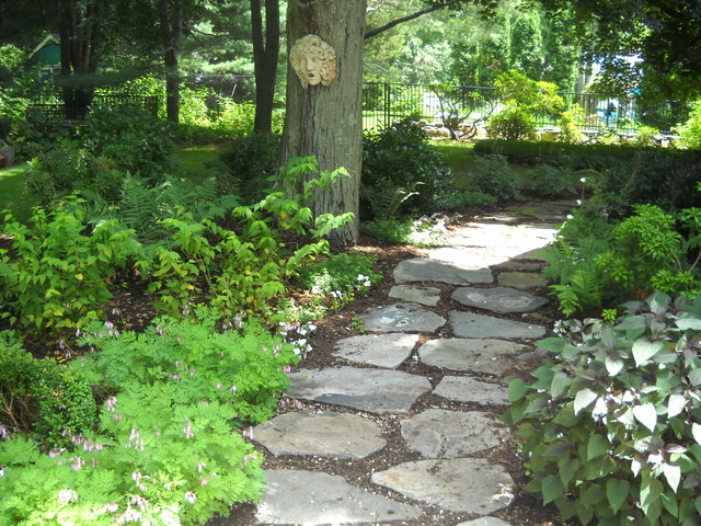 A natural stepping stone path in a shade garden rustic for Natural garden designs