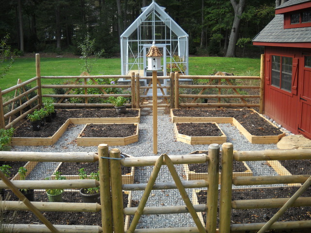 A vegetable garden with a greenhouse