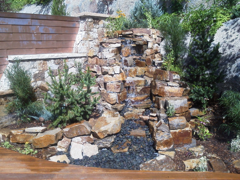 A water feature on a back patio area