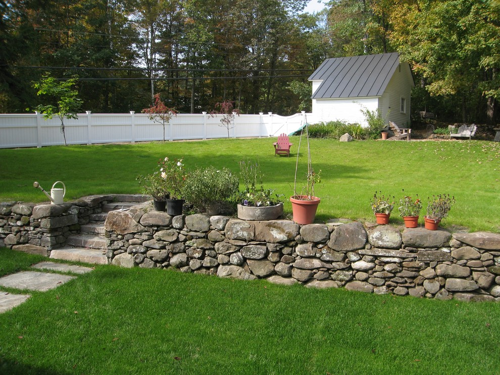 Photo of a traditional backyard landscaping in Burlington.