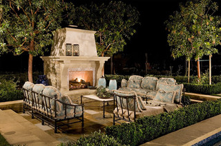 Outdoor fireplace with lots of seating.