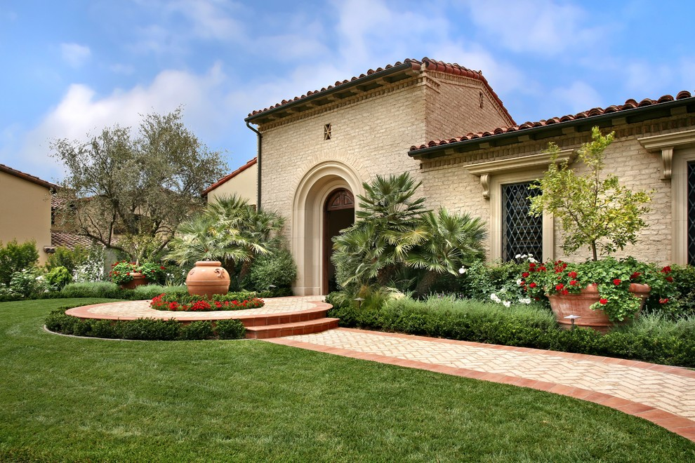This is an example of a mediterranean front yard landscaping in Los Angeles.