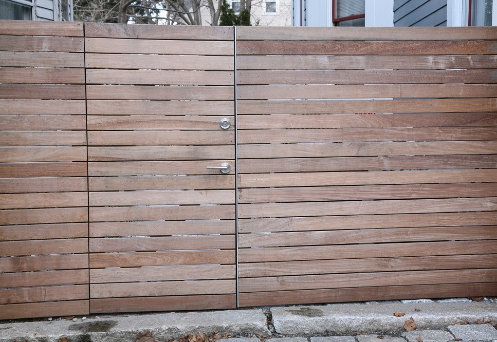 An ipe fence and gate provide a separation between public and private spaces.