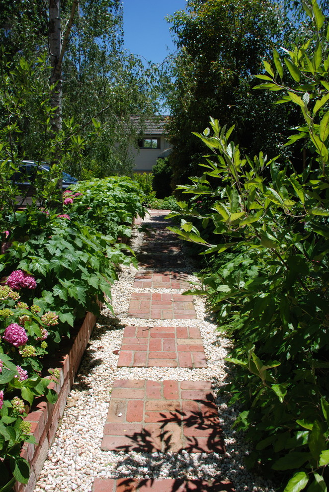 Inspiration for a traditional brick landscaping.
