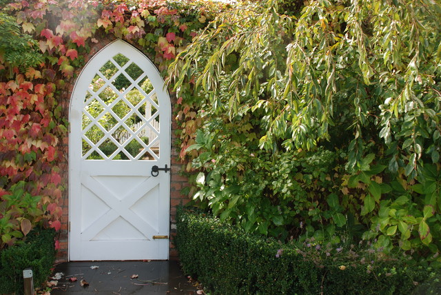 Photo of a shabby-chic style garden path for fall.