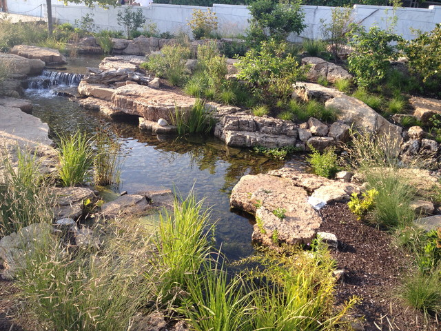 Aquascape ecosystem waterfall pond installation shedd for Pond installation