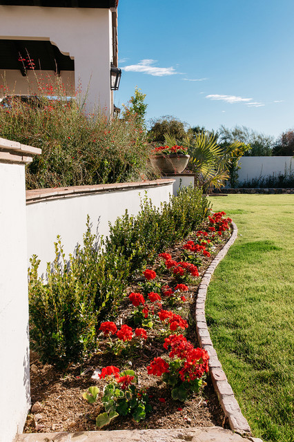 Inspiration for a large mediterranean full sun and drought-tolerant backyard brick garden path in Phoenix for spring.