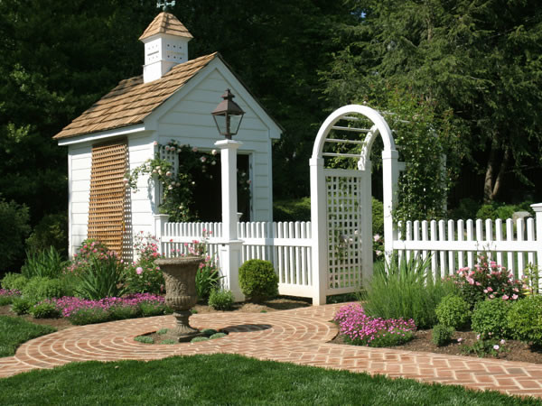 Arched Rose Trellis and White Picket Fence traditional-landscape