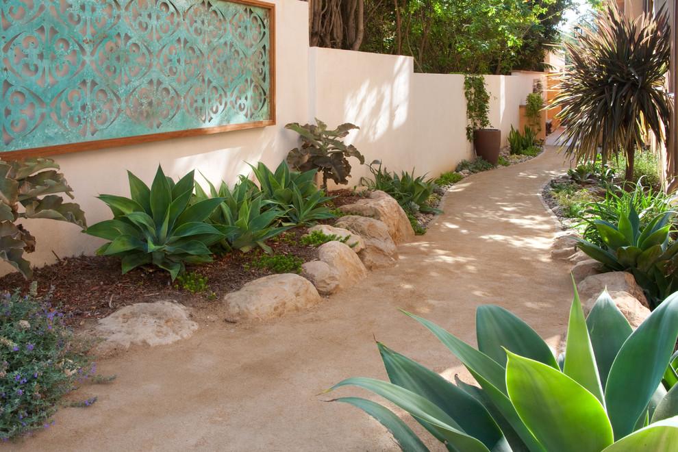 Design ideas for a large mediterranean backyard landscaping in Santa Barbara.