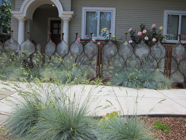 Artistic fence as garden highlight eclectic landscape
