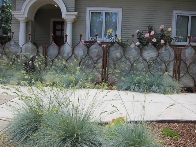 Artistic fence as garden highlight eclectic-landscape