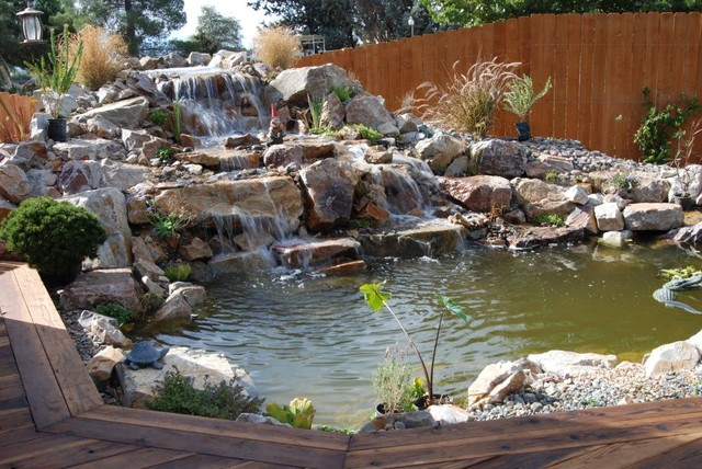 Awesome koi pond and waterfall tropical landscape for Awesome koi ponds