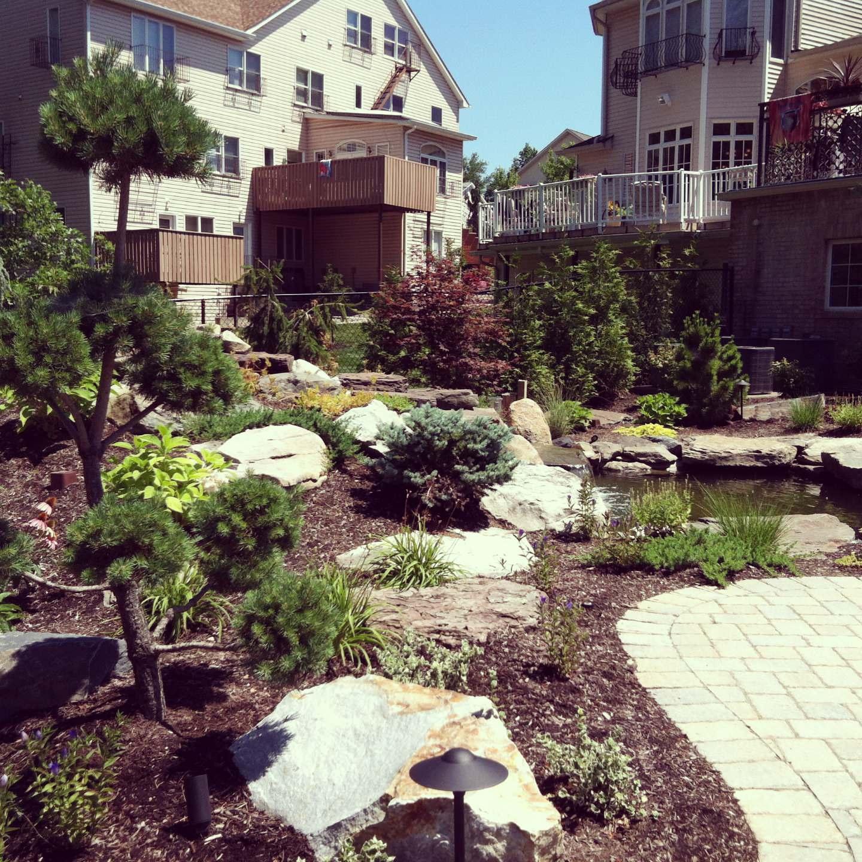 backyard landscape waterfall,paver patio with paver pathway