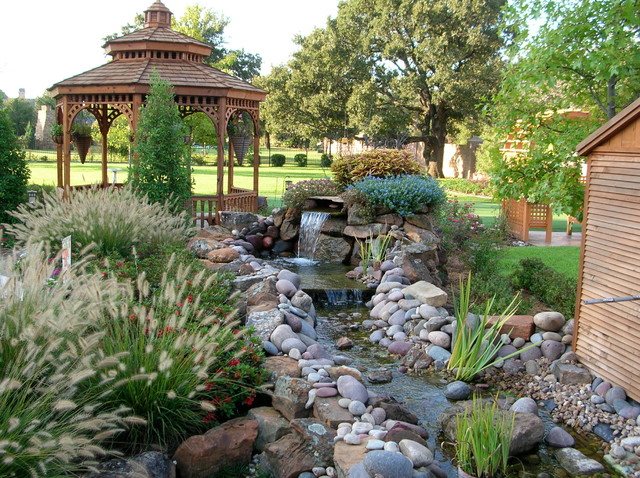 Backyard landscapes with water features traditional for Water garden landscaping