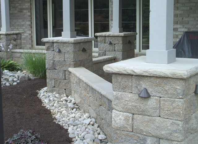 Landscape Block Wall Systems : Backyard patio with accent lighting contemporary