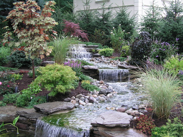 Backyard stream into ponds eclectic landscape new for Outdoor yard ponds