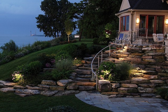 Backyard walk out basement sloped planting and steps Walkout basement landscaping pictures