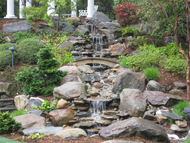 backyard waterfall pond and garden in connecticut by matthew