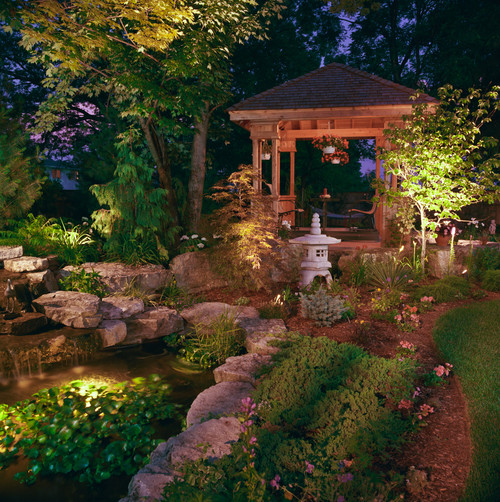 This stunning garden has a number of different lighting elements working together to brighten up the space. The lighting here creates a dramatic effect, adding character to the garden that is not seen in the light of day.