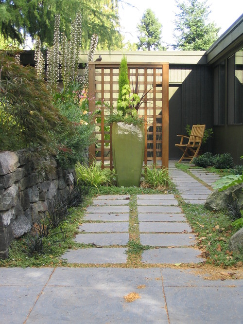 A clean lattice fence divides this space without blocking too much visibility.