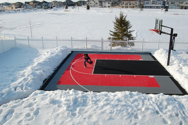 Asphalt basketball court in backyard Basketball court installation cost