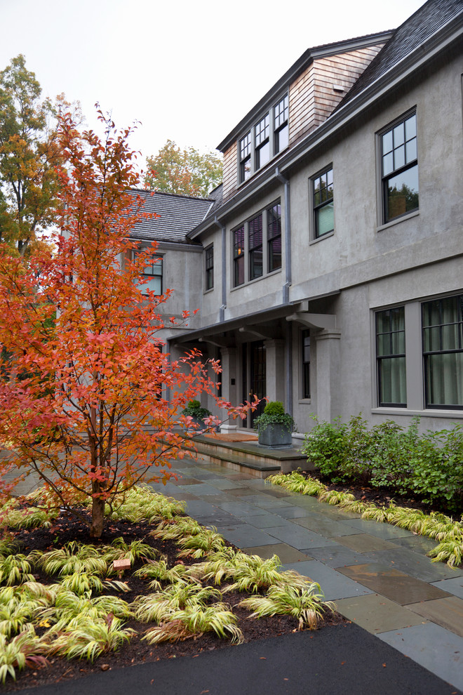 Photo of a traditional front yard stone landscaping in Boston for fall.