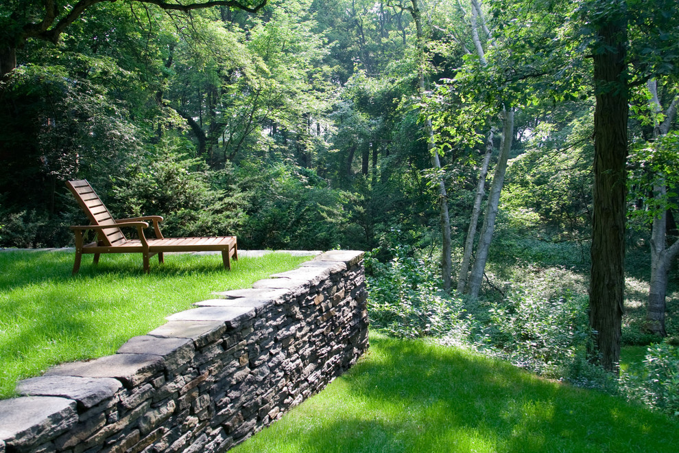This is an example of a contemporary shade backyard landscaping in Boston.