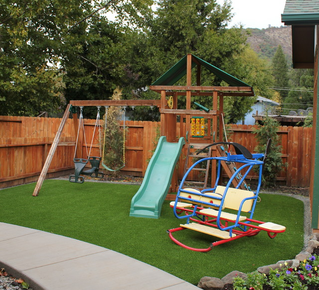 Photo of a small landscaping for spring. - Bend, OR Backyard Playground Grass - After - Landscape - By TURF-N