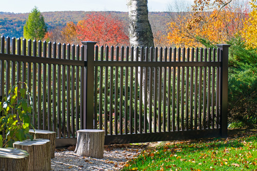 A simple vinyl fence designed to resemble a wrought iron fence. The fence can be seen through, which keeps the beautiful view of the valley below visible.