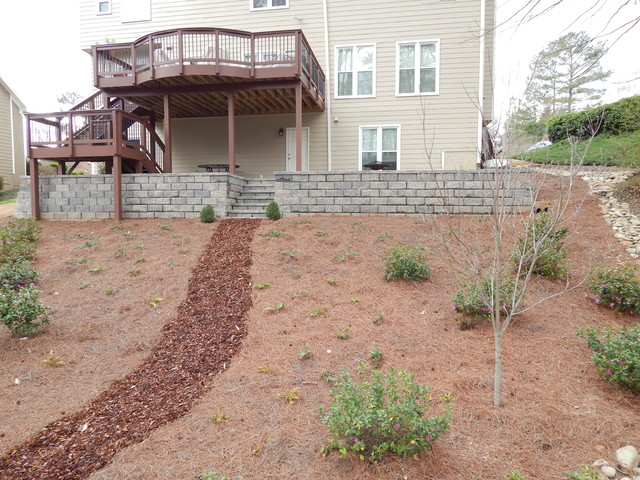 Landscaping Paver Block : Block wall and tumbled paver patio
