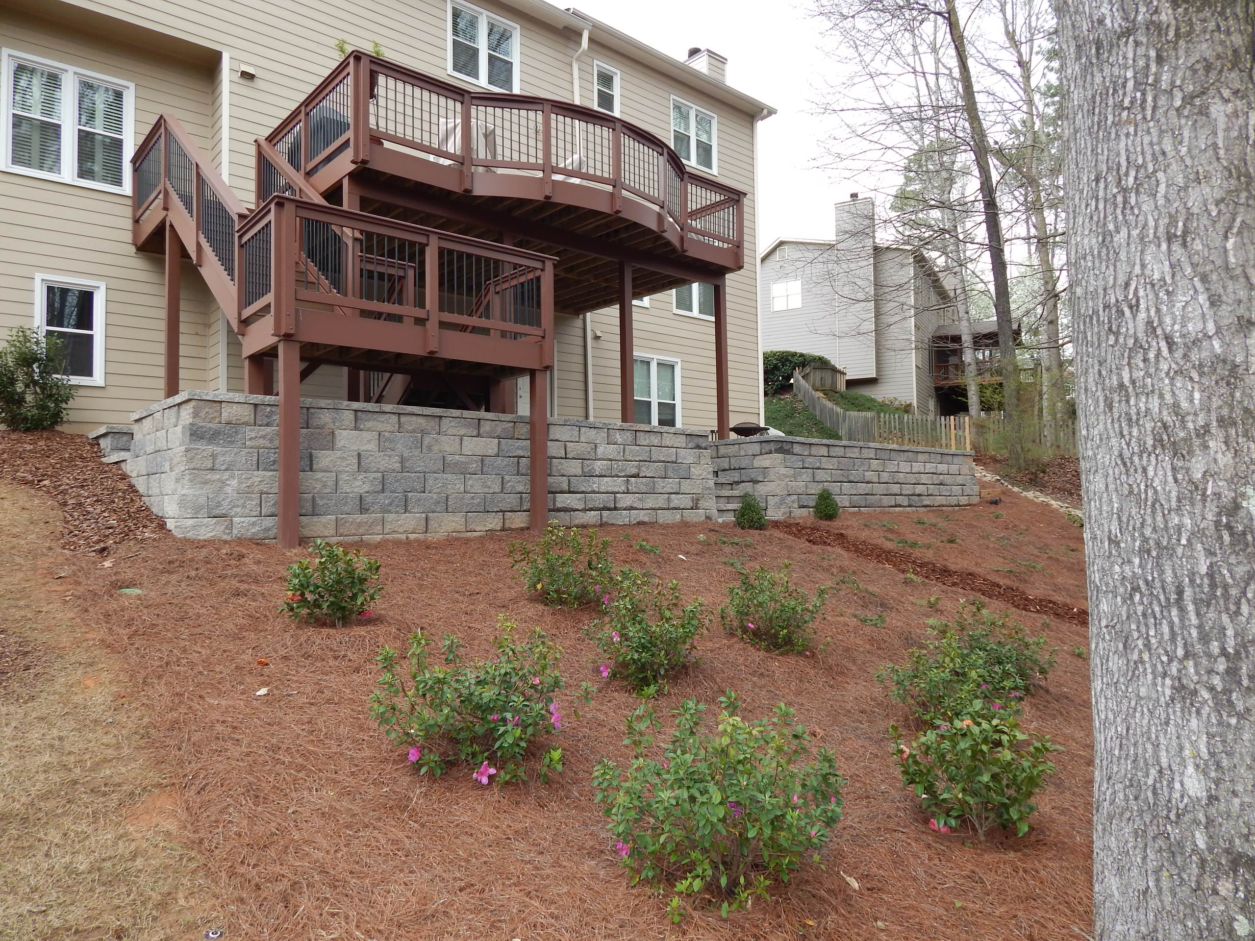 Block wall and tumbled paver patio