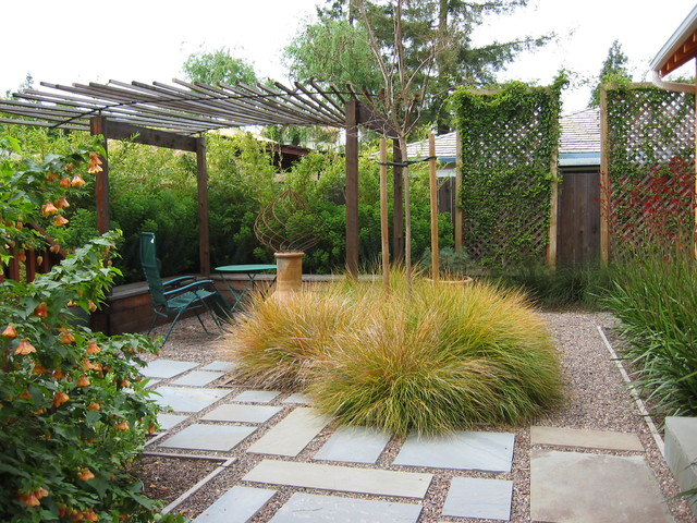 Photo Of A Mid Sized Mediterranean Partial Sun Backyard Gravel Landscaping  In San Francisco.