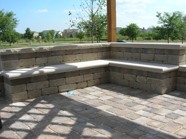 brick patio seat wall and pergola transitional landscape