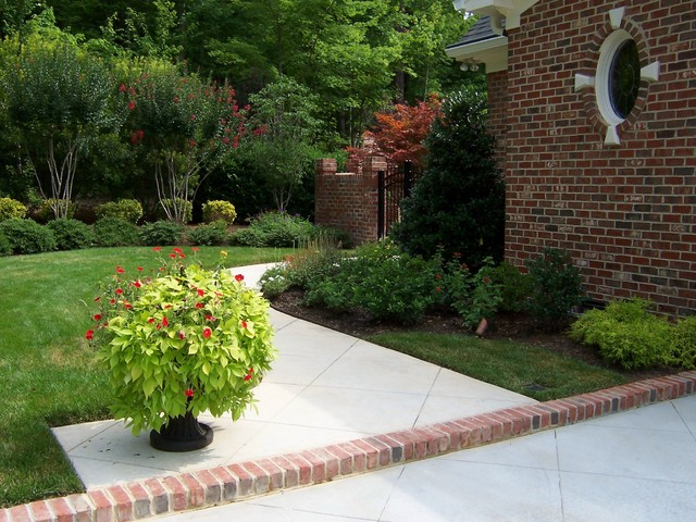 Brick Walled Courtyard traditional-landscape