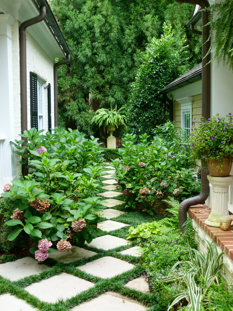 Inspiration for a traditional full sun concrete paver garden path in Atlanta.