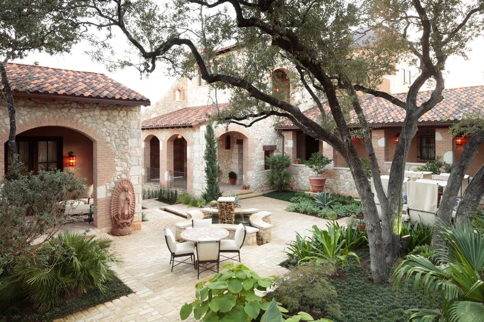 Design ideas for a mediterranean courtyard landscaping in Austin.
