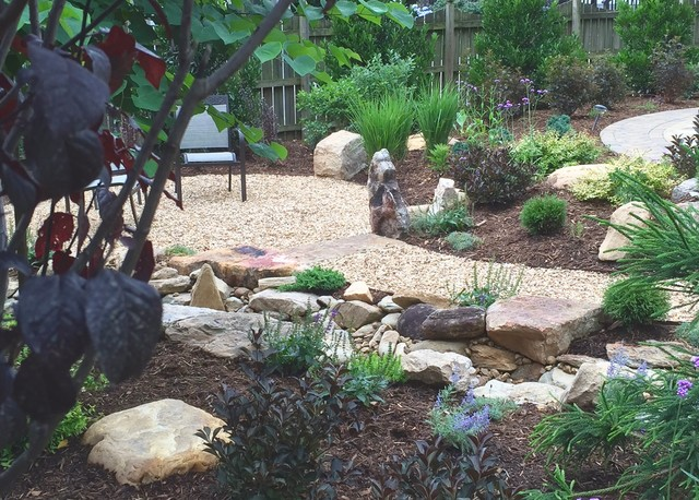 Photo of a craftsman full sun landscaping in Charlotte.