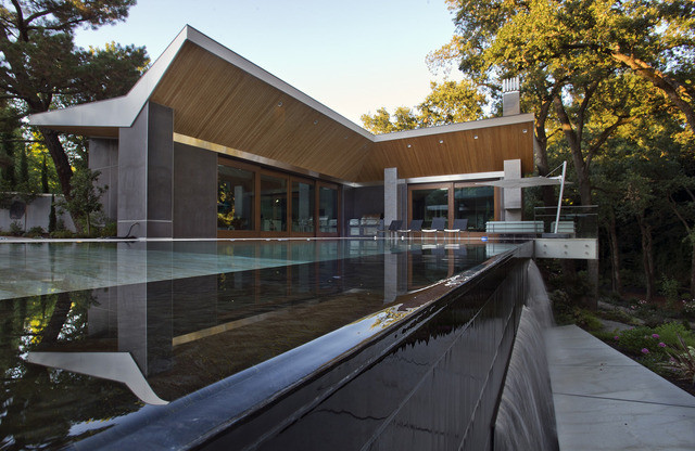 Butterfly Roof Of Pool House Reflected In Infinity Edge