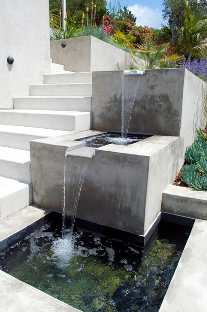 This is an example of a contemporary full sun side yard water fountain landscape in San Francisco.