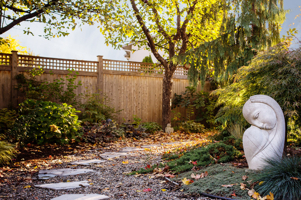 Design ideas for an asian backyard stone landscaping in Ottawa for fall.