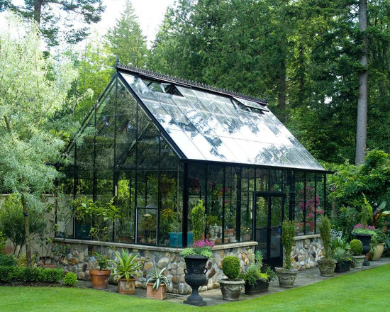 Cape Cod 16x20 Greenhouse - This is our 16x20 Cape Cod Greenhouse by BC Greenhouse Builders. Black frame, double door in the sidewall, decorative ridge cresting.   Seed starts, tropicals, overwintering - you name it, it happens here!