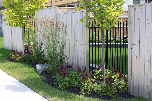 Cedar Fence with Trees and Ornamental Iron transitional-landscape