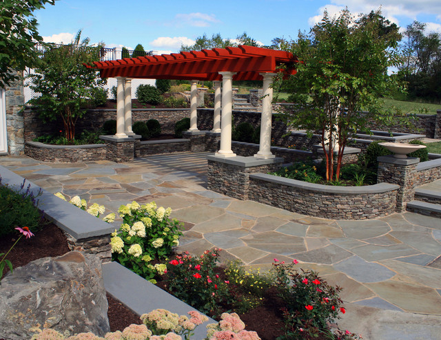 Cedar pergola over flagstone dining area traditional landscape