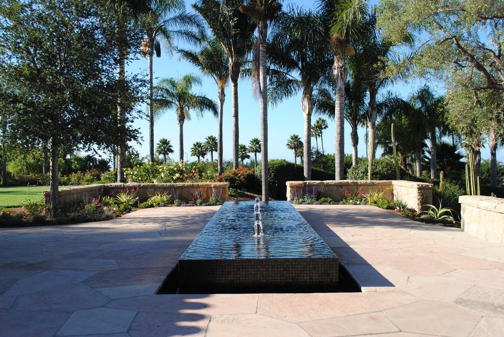 Inspiration for a large transitional backyard stone water fountain landscape in Santa Barbara.