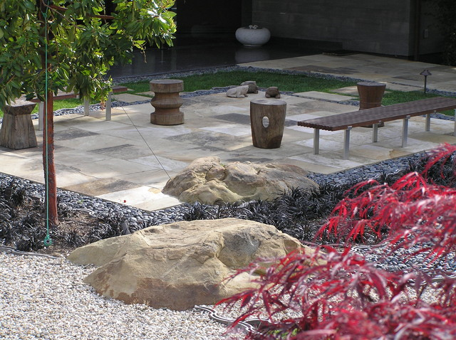 Design Ideas For A Large Modern Backyard Stone Landscaping In Santa Barbara.