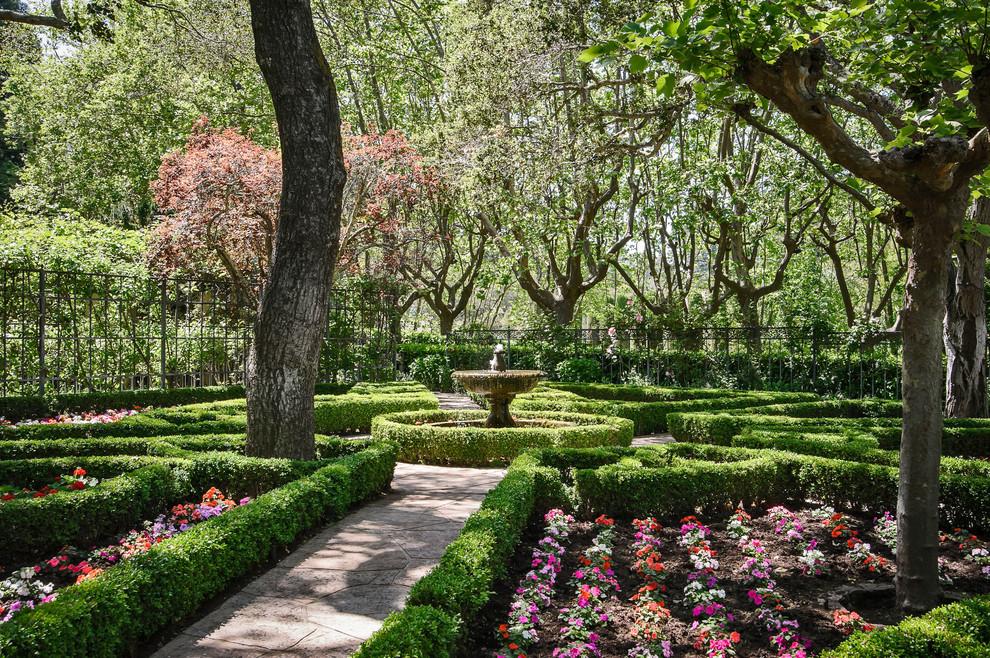 Photo of a large traditional partial sun backyard formal garden in San Francisco.