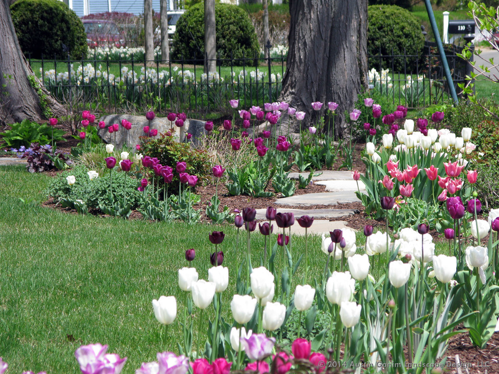 Design ideas for a traditional partial sun front yard stone landscaping in New York for spring.