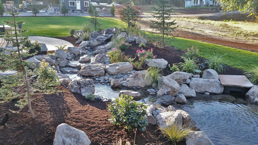 This is an example of a large backyard water fountain landscape in Portland.