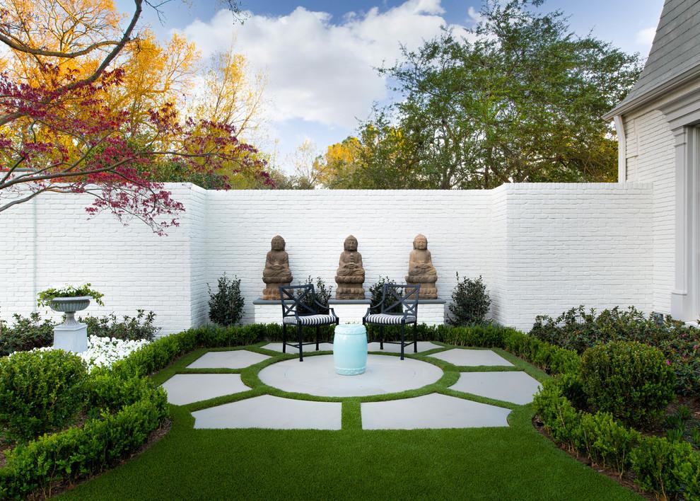 Photo of a traditional concrete paver formal garden in Dallas.