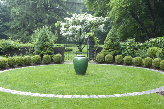 Classic Urn in a courtyard garden traditional landscape